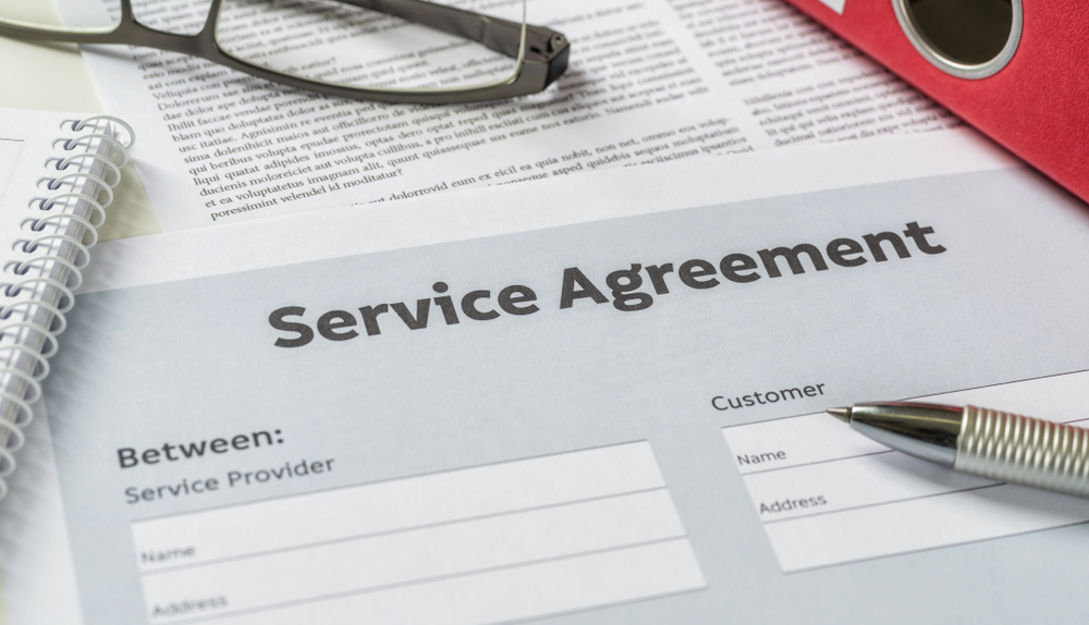 Service agreement on paper with a pen