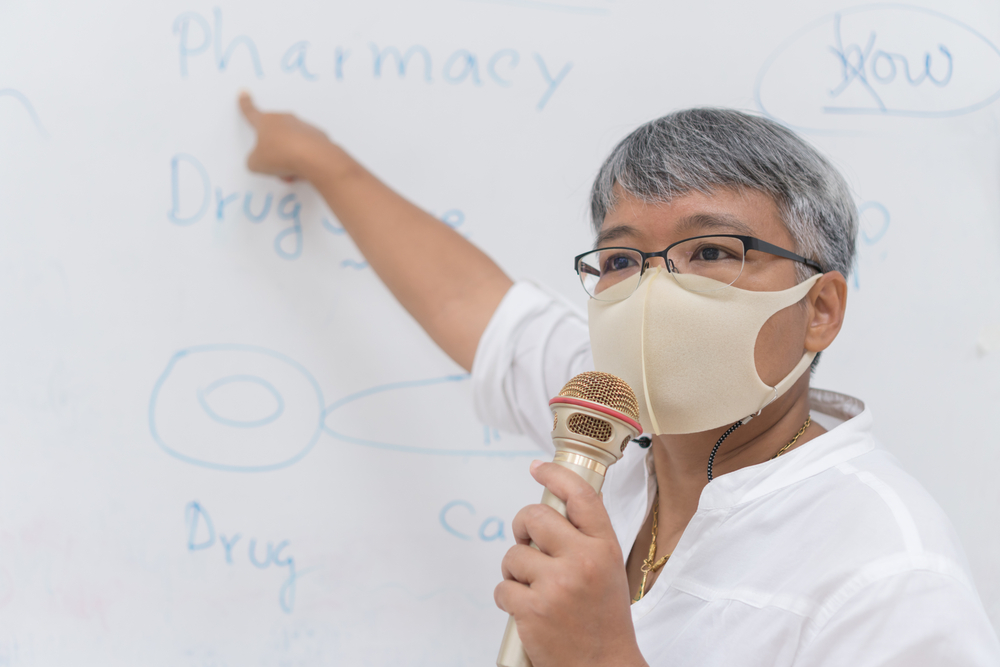 Teacher Wearing a Mask With a Microphone